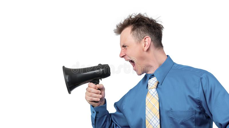 Portrait of a man yelling into a megaphone, side view. Isolated on white background royalty free stock photo
