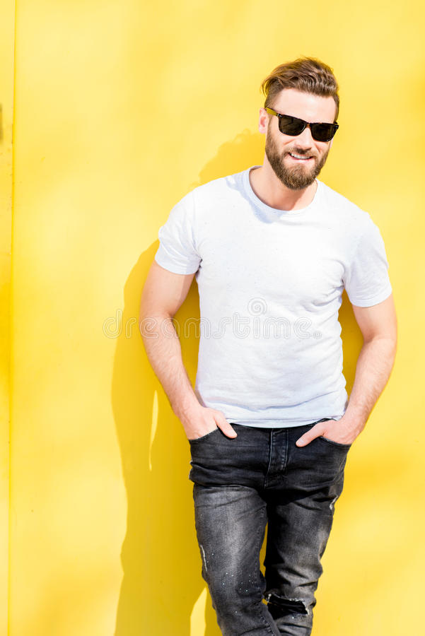 Portrait of a man on yellow background stock images