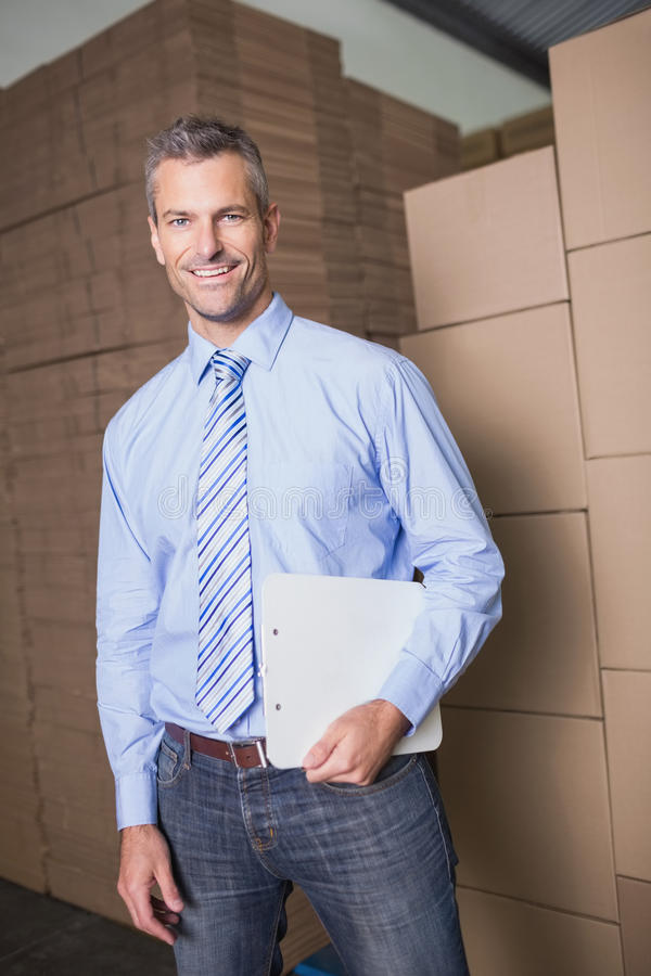 Portrait of manager holding clipboard in warehouse royalty free stock photography