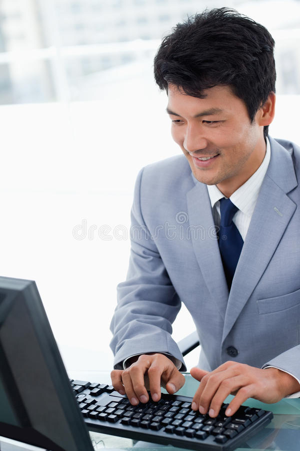 Portrait of a manager using a computer. In his office stock photo