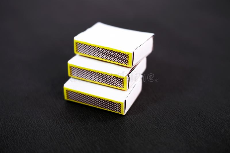 Portrait of match box. Isolated on the black background royalty free stock images