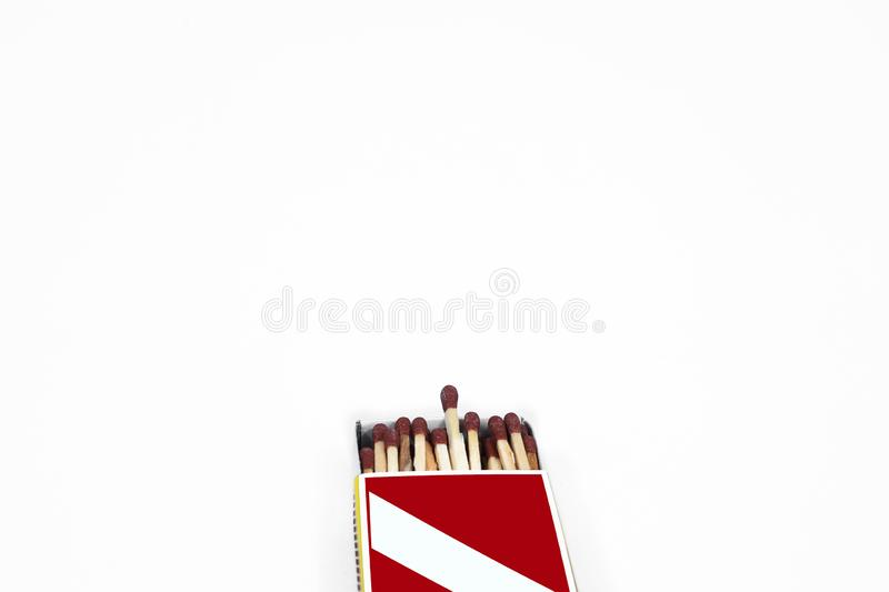 Portrait of matches in the match box. Isolated on the white background royalty free stock photo
