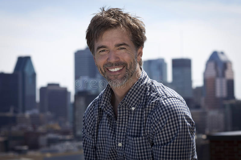 Portrait Of A Mature Active Man Smiling In a city stock photography