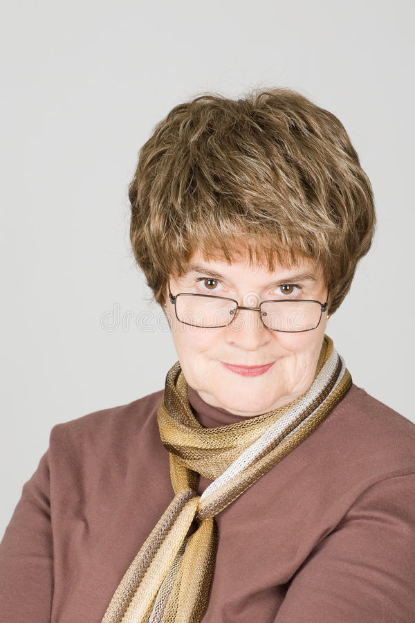 Portrait of a mature aged smiling woman. Studio portrait of a mature aged smiling woman stock images