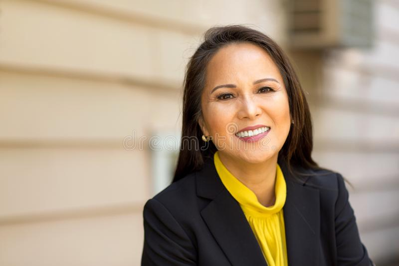 Portrait of a mature Asian woman in a business suit. royalty free stock photography