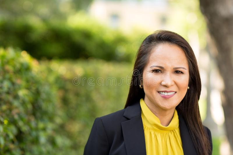 Portrait of a mature Asian woman in a business suit. stock photo
