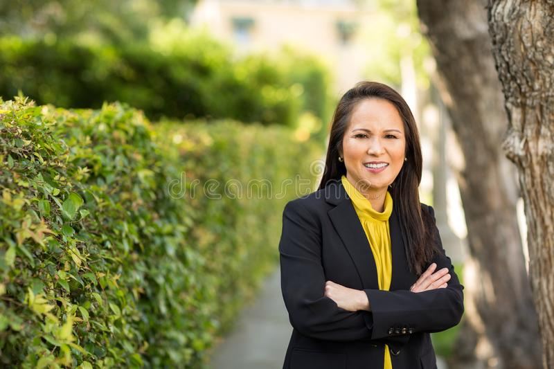 Portrait of a mature Asian woman in a business suit. royalty free stock images