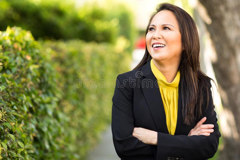 Portrait of a mature Asian woman in a business suit. royalty free stock photo