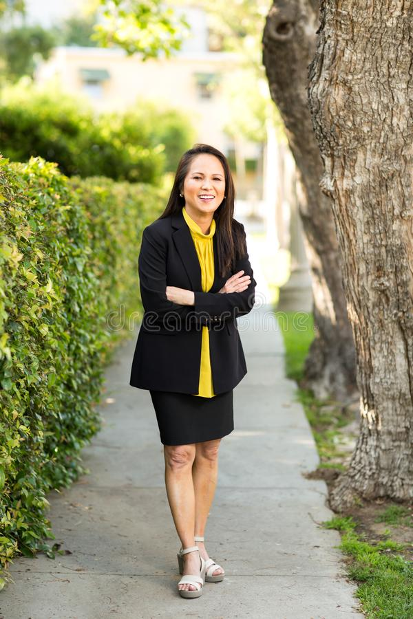 Portrait of a mature Asian woman in a business suit. stock photography