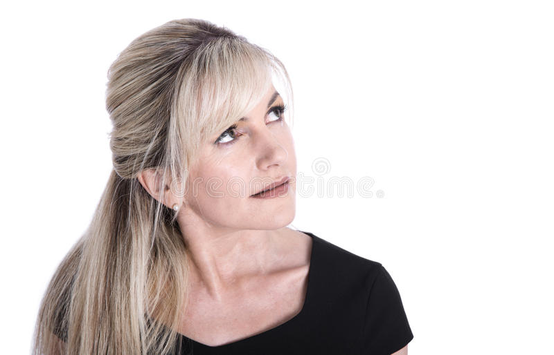 Portrait of mature beautiful blond woman face looking up. royalty free stock photography