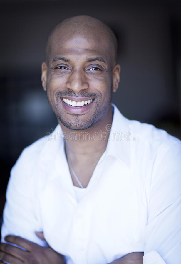 Portrait Of A Mature Black Man Smiling At The Camera. stock photos