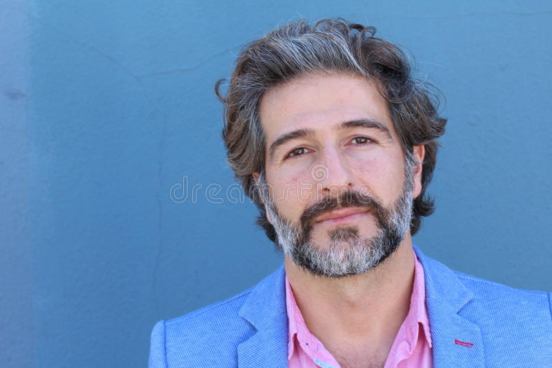 Portrait of mature business man with grey beard and hair alone with copy space stock photography