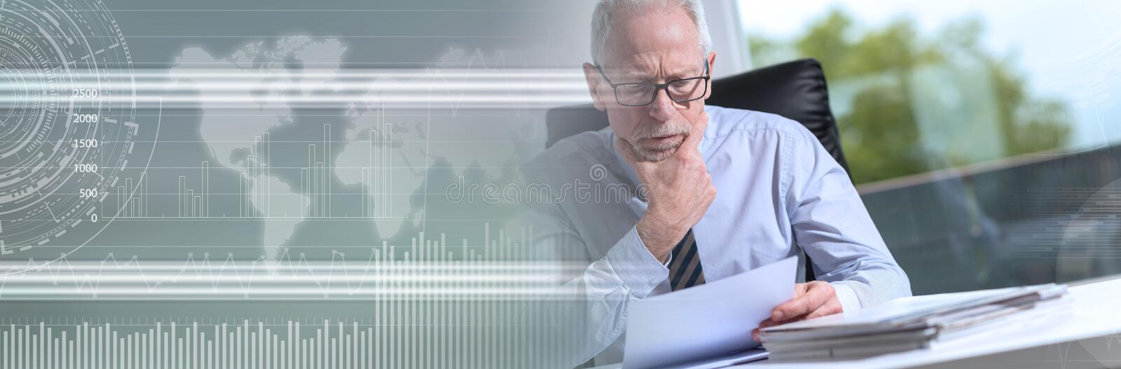 Portrait of mature businessman checking a document. panoramic banner stock image