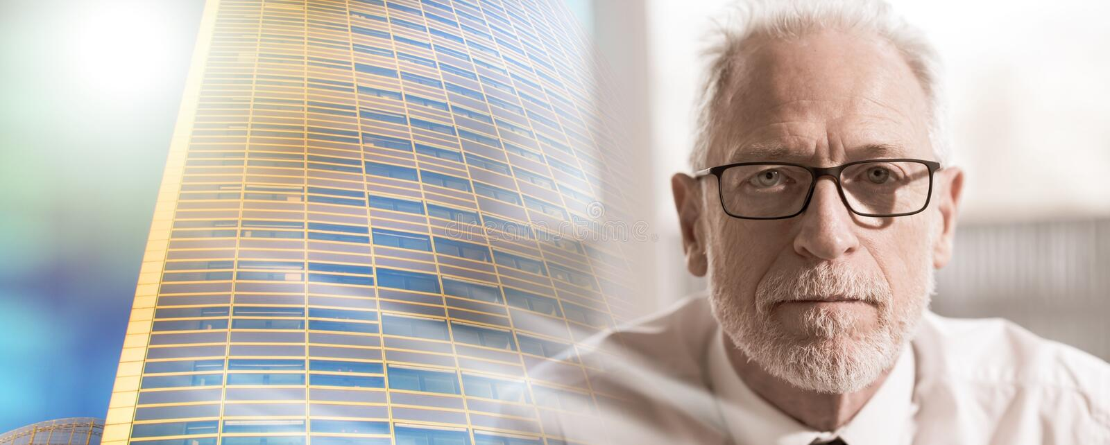 Portrait of mature businessman; multiple exposure stock photography