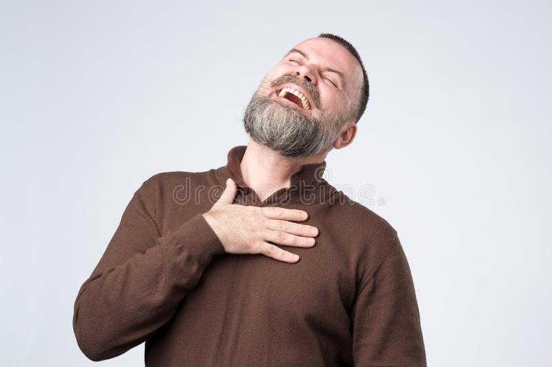 Portrait of a mature caucasian man with beard laughing stock photo