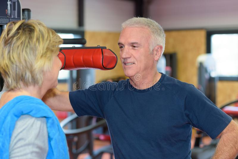Portrait mature couple in gym stock photography