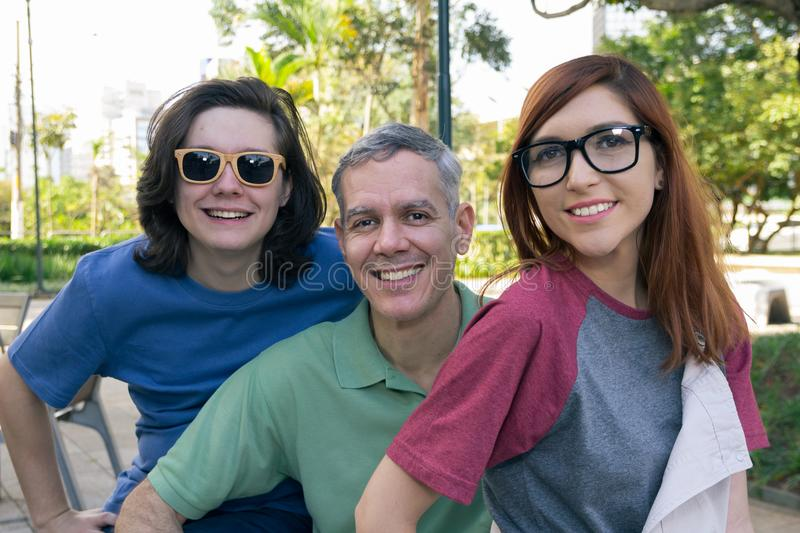 Portrait of Mature dad and teenage son and daughter wearing eyewear. Father Day. Concept of family, happiness, friendship. stock images