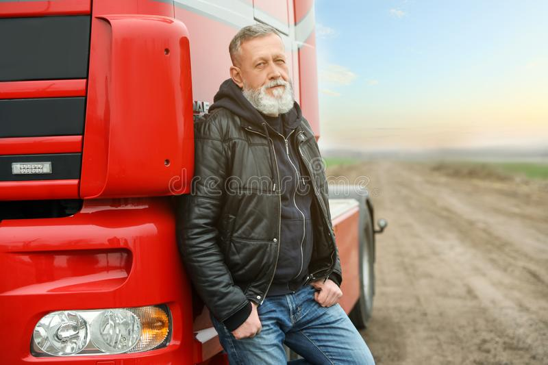 Portrait of mature driver at modern truck outdoors royalty free stock photography