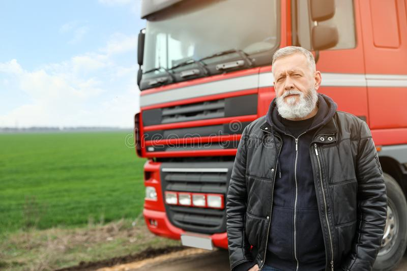 Portrait of mature driver at modern truck outdoors royalty free stock photos