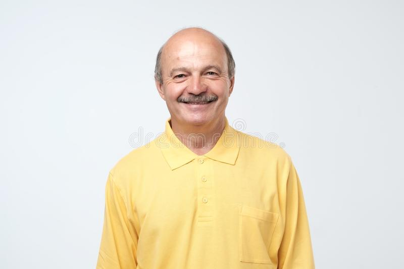 Portrait of mature european man looking at camera and smiling. stock photo