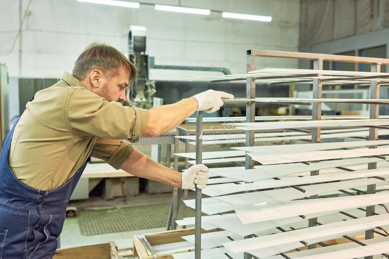 Factory Worker Moving Materials stock photography
