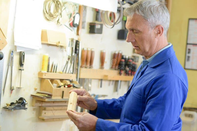 Portrait mature handyman at diy workshop stock image