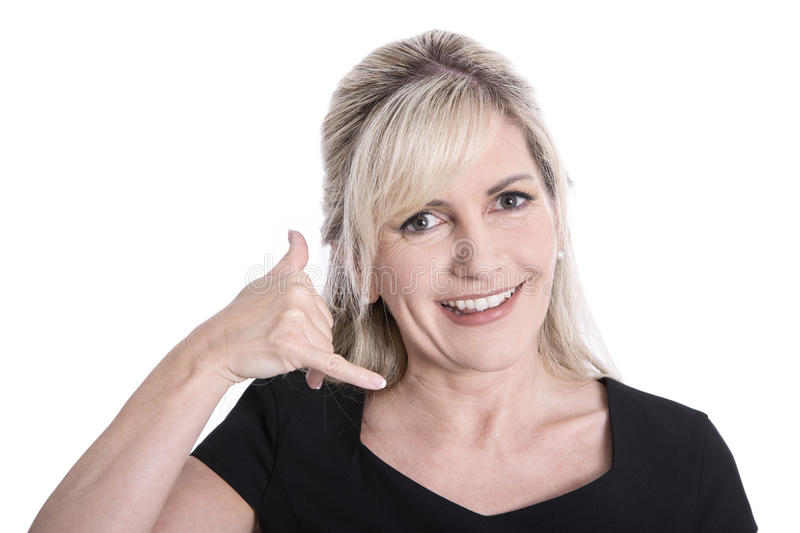 Portrait of mature isolated woman making hand gesture for calling. royalty free stock photo