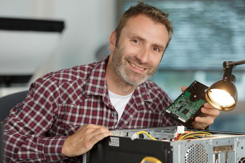 Portrait mature male computer technician royalty free stock photos