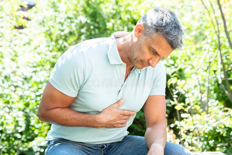 Man Having Heart Attack stock photos
