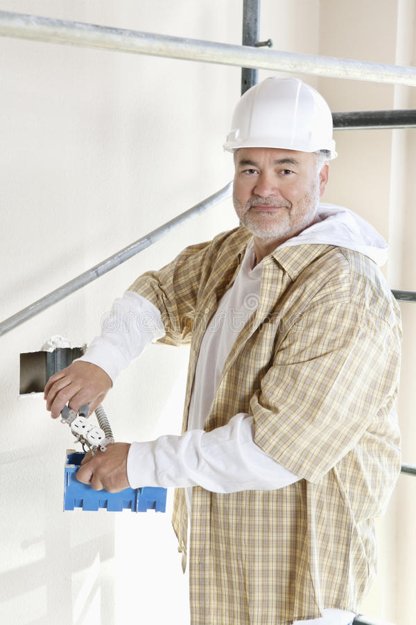 Portrait of a mature man holding construction equipment stock photos