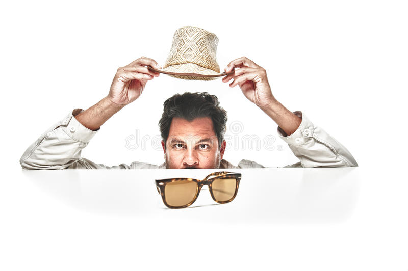 Portrait of a mature man holding his hat up royalty free stock photography