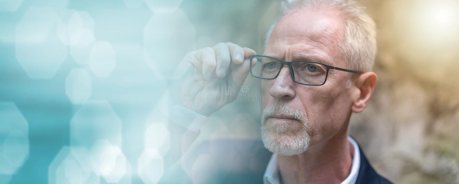 Portrait of mature man, light effect; panoramic banner stock photo