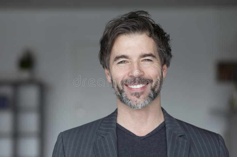 Portrait Of A Mature Man Smiling stock image