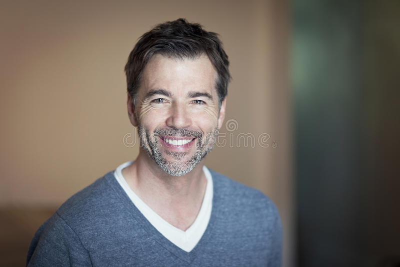 Portrait of a mature man smiling royalty free stock photography