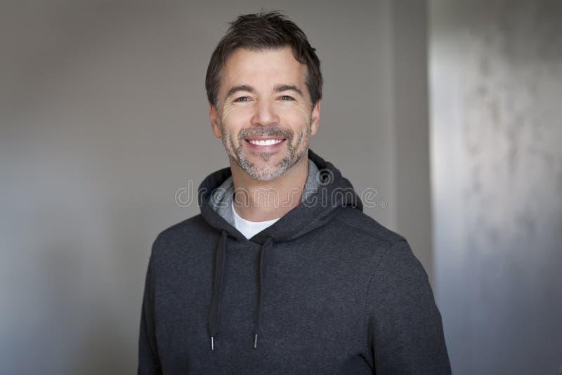 Portrait of a mature man smiling stock photos