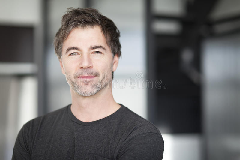Portrait Of A Mature Man Smiling At The Camera. stock photos