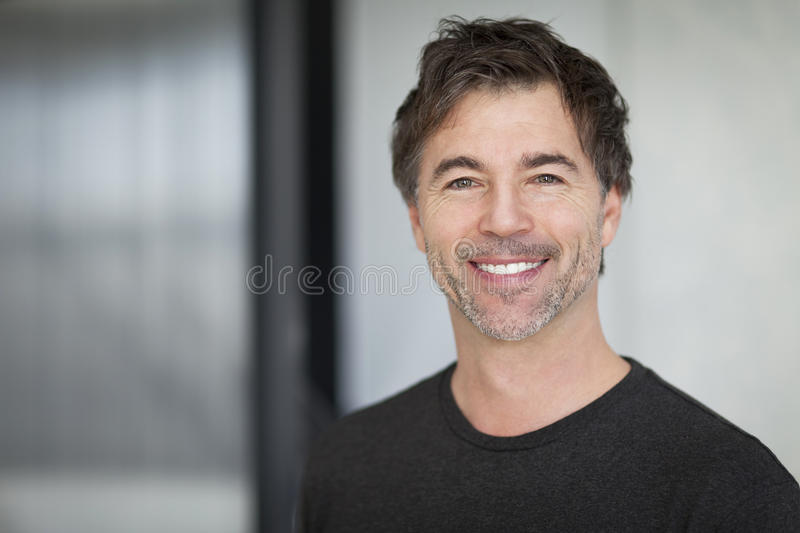 Portrait Of A Mature Man Smiling At The Camera. stock photography