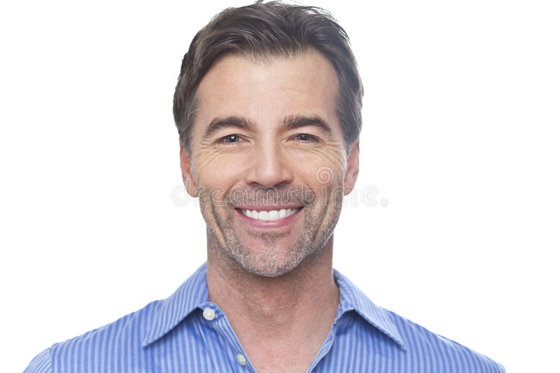 Portrait Of A Mature Man Smiling At The Camera stock images