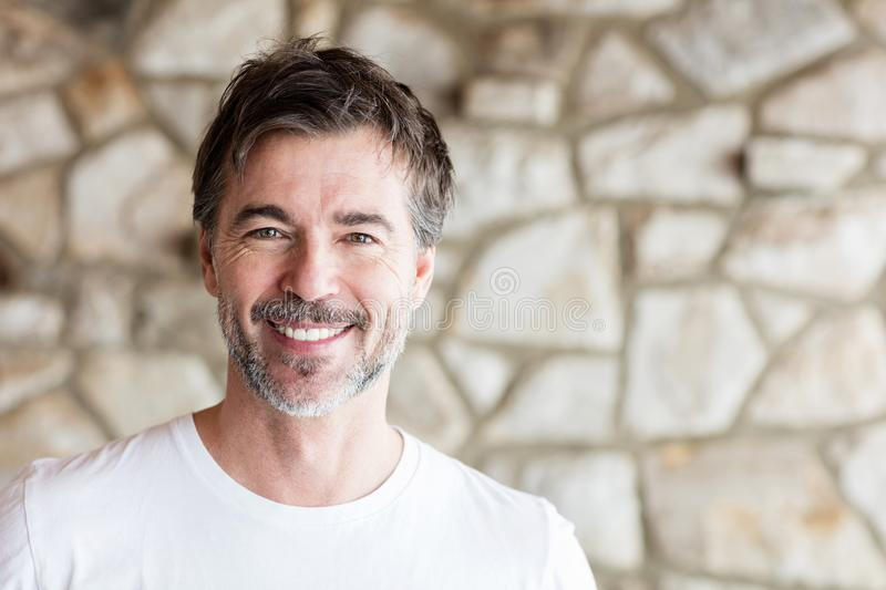 Portrait Of A Mature Man Smiling At The Camera. royalty free stock image