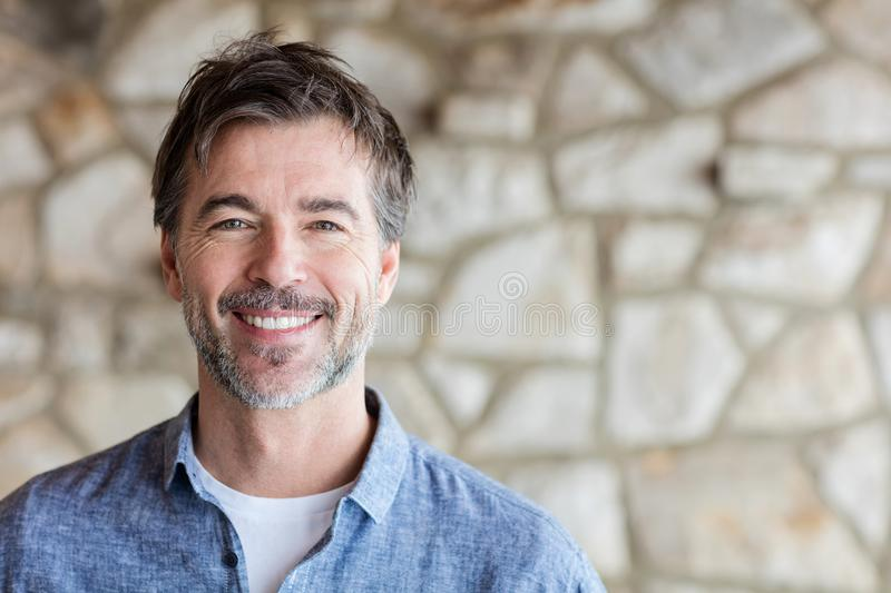 Portrait Of A Mature Man Smiling At The Camera. stock images