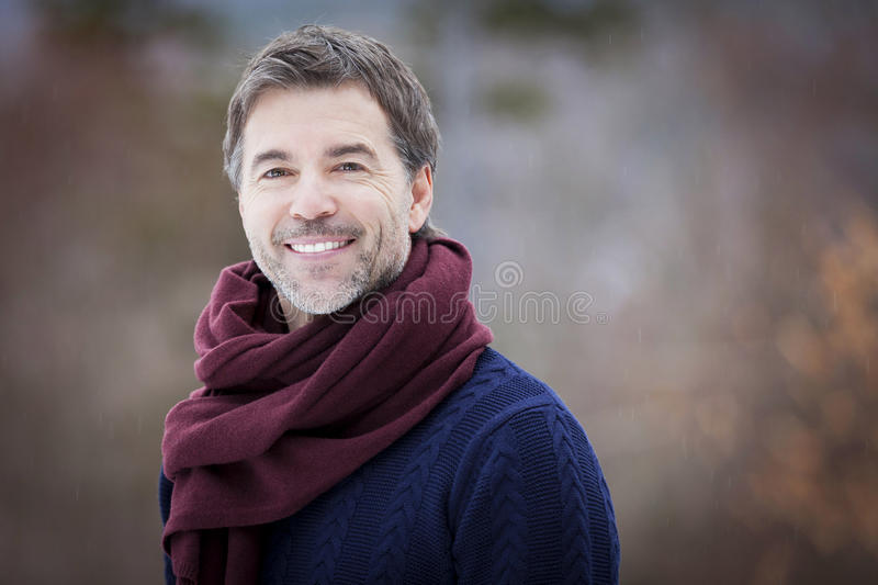 Portrait Of A Mature Man Smiling And looking away. royalty free stock images