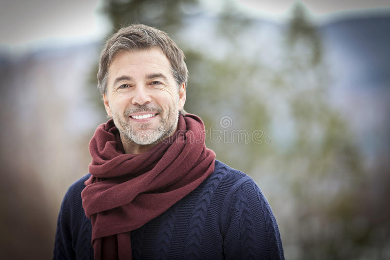 Portrait Of A Mature Man Smiling And looking away. stock photo
