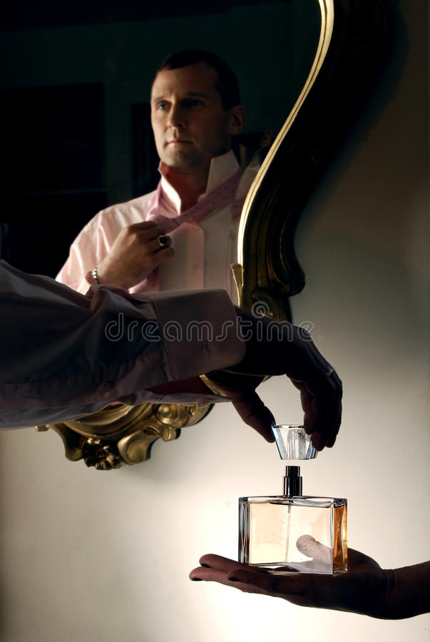 Portrait of a mature man. Tasting parfume royalty free stock image