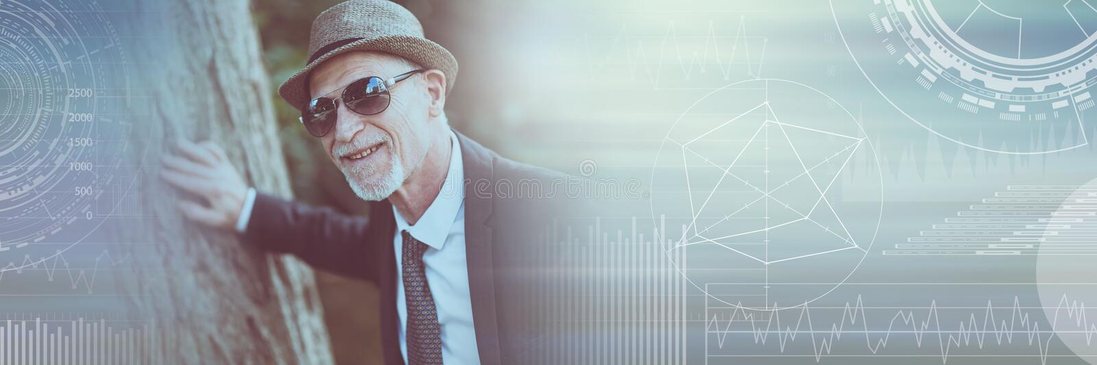 Portrait of mature man wearing sunglasses, light effect; panoramic banner royalty free stock photo