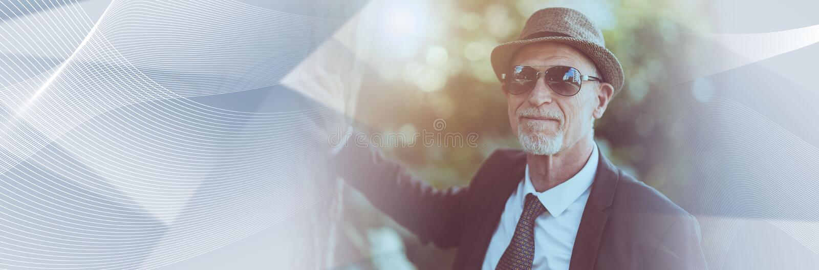 Portrait of mature man wearing sunglasses, light effect. panoramic banner stock photo