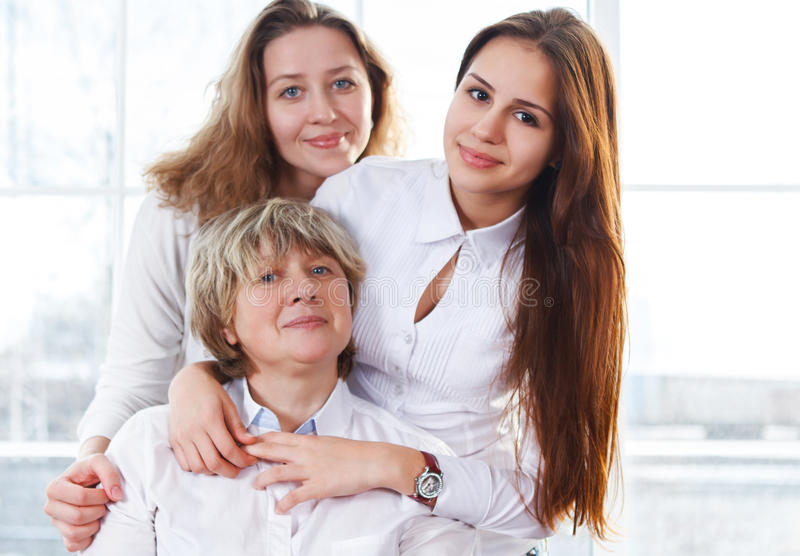 Portrait of a mature mother and adult daughter and teen granddaughter stock photos