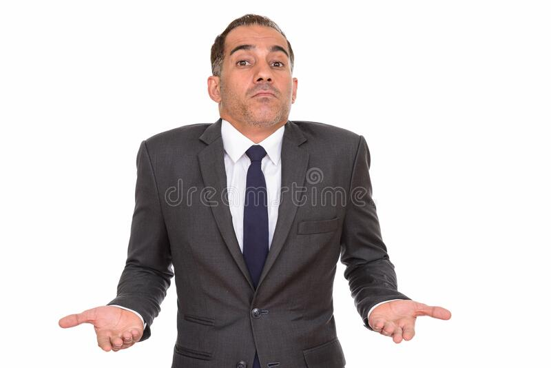 Portrait of mature Persian businessman shrugging shoulders royalty free stock photos