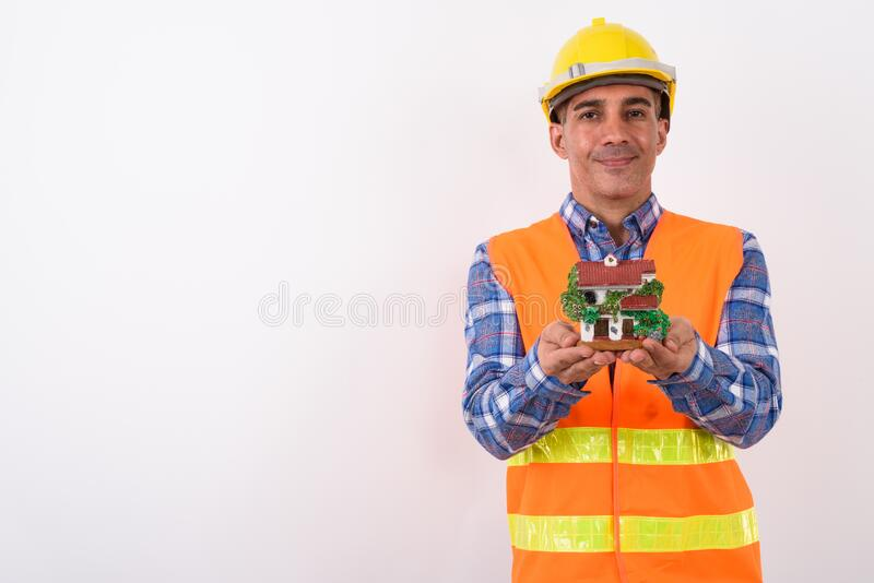 Portrait of mature Persian man construction worker. Studio shot of mature Persian man construction worker against white background royalty free stock image
