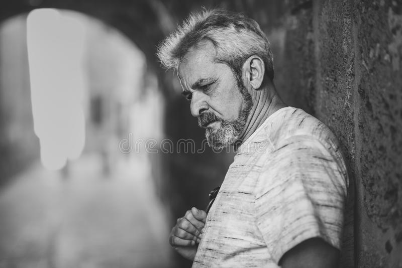 Portrait of a mature serious man in urban background. royalty free stock photos