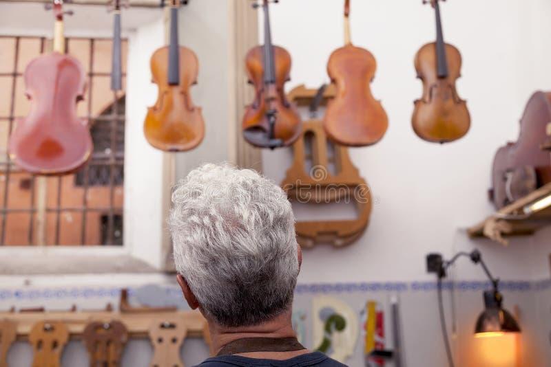 Portrait of mature violin maker stock image